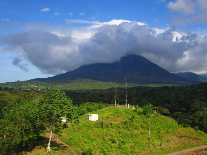 Volcano Arenal covered by some clouds